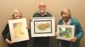 Diana Beaumont, John Ridyard and Ann Carr with their paintings